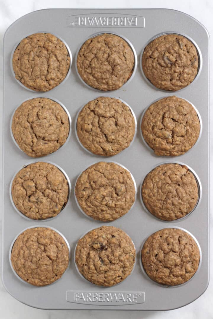 looking down on 12 baked muffins in pan