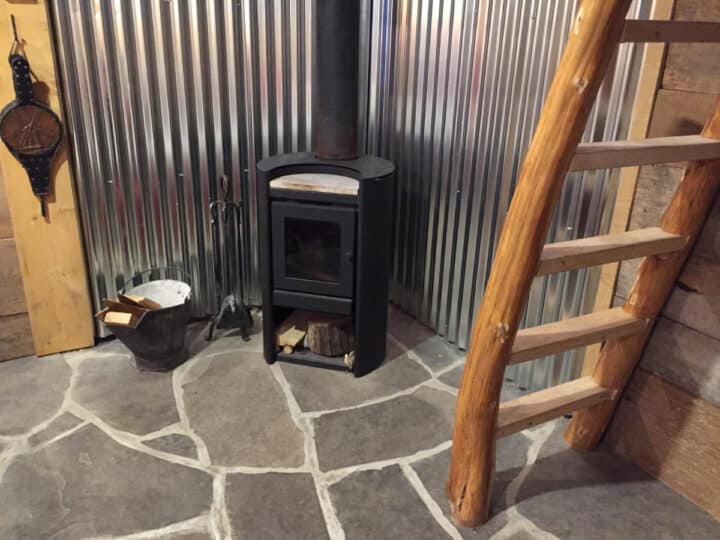 black woodstove on flagstone floor