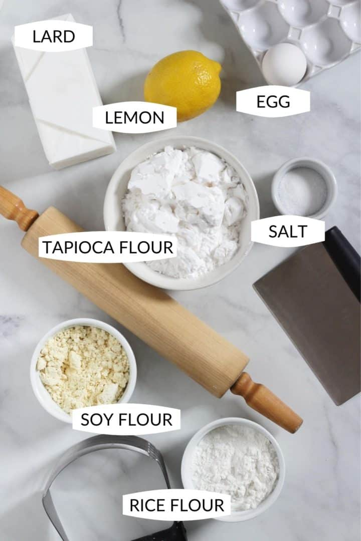 ingredients for gluten free pie crust in individual bowls with labels