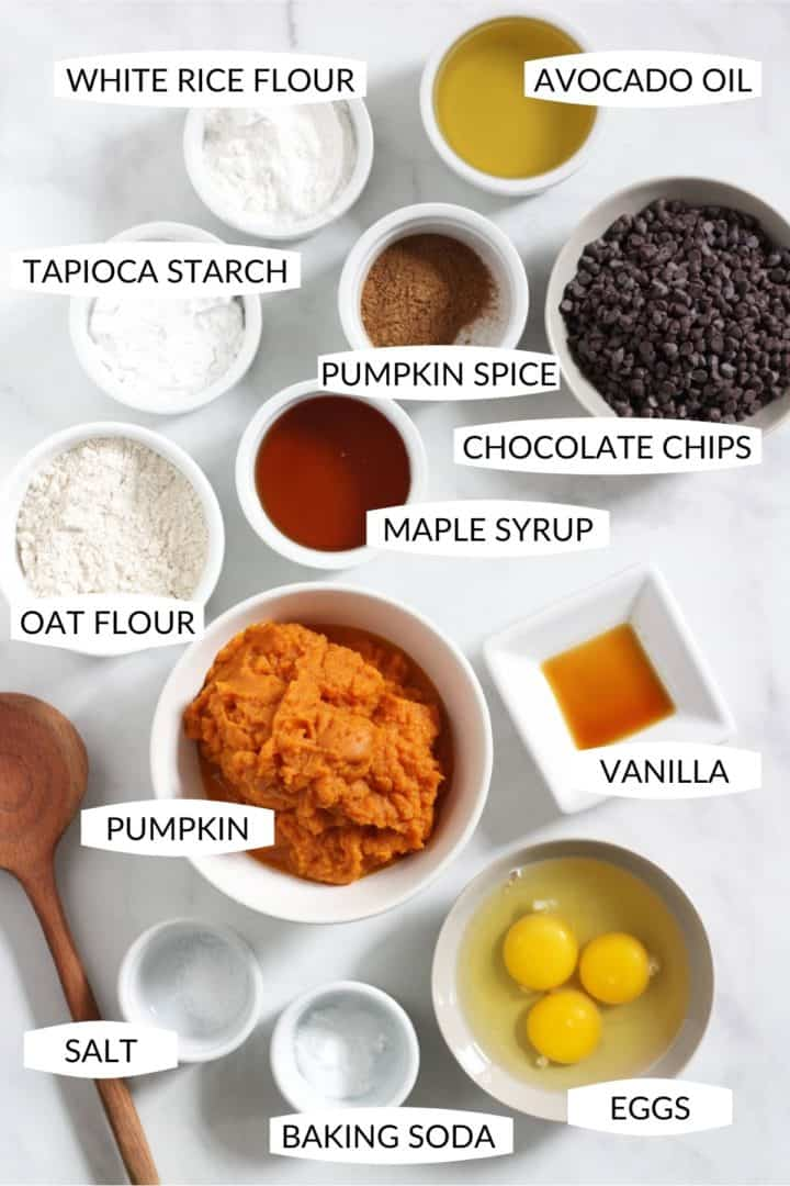 individual ingredients for pumpkin spice muffins in small bowls