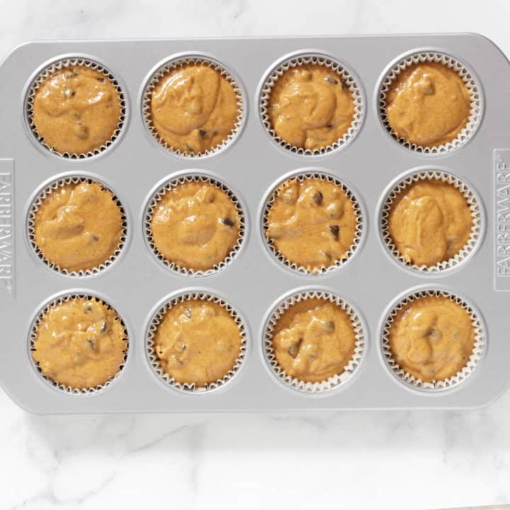 wet muffin batter in muffin pan