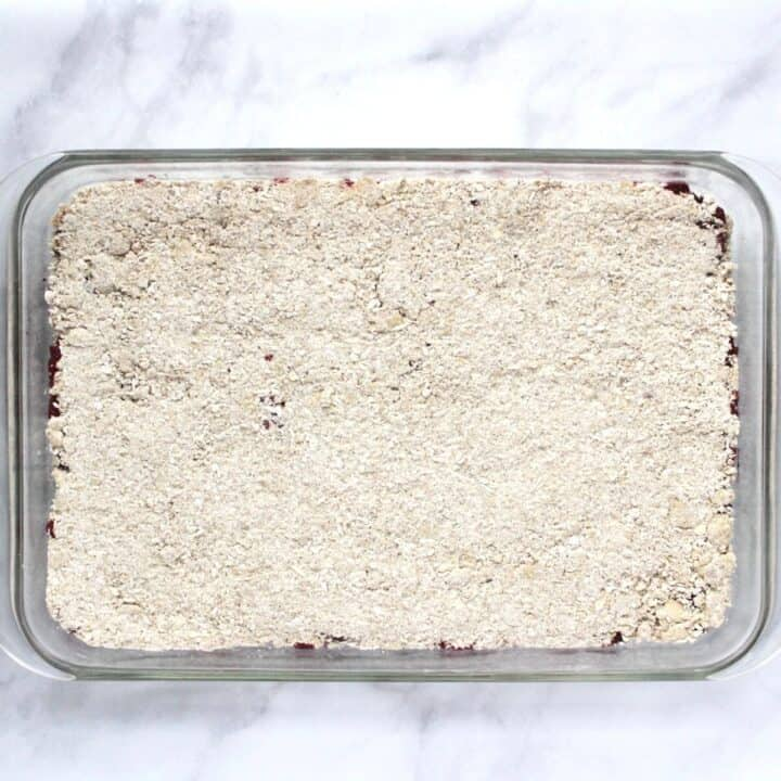 crumb mixture covers the filling in glass baking dish