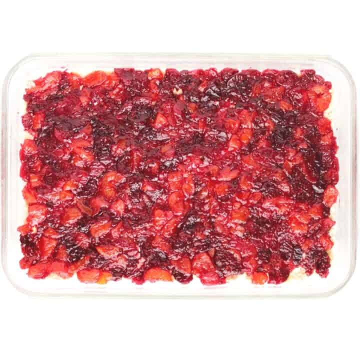 layer of cranberry-apricot filling in rectangular glass pan