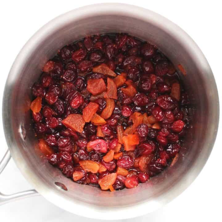 cranberries and chopped apricots in pot