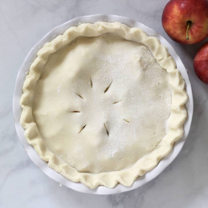unbaked pie with slits poked in top crust