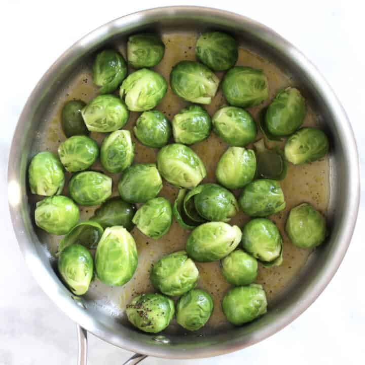 Brussels sprout in pan have become vivid green through steaming