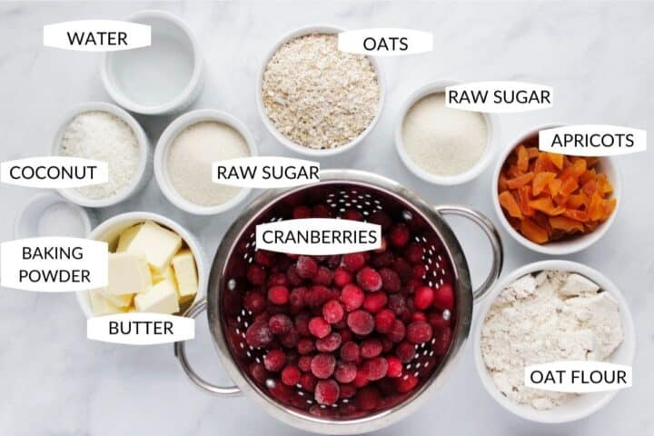 ingredients for cranberry bars in individual bowls with labels