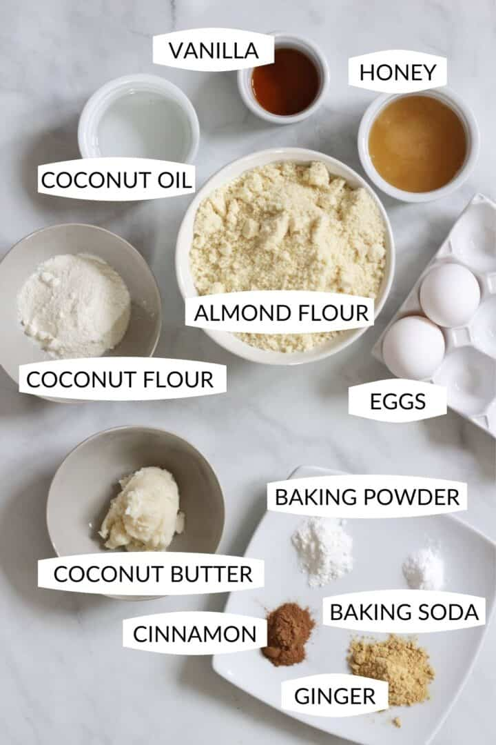 ingredients for soft gingerbread cookies in individual bowls with labels