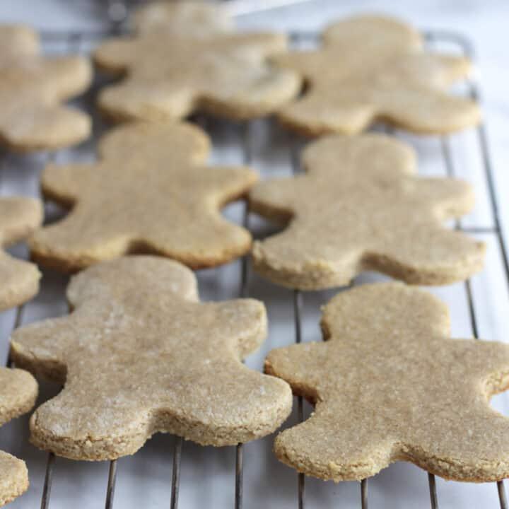 gingerbread men cookies cooling on rack