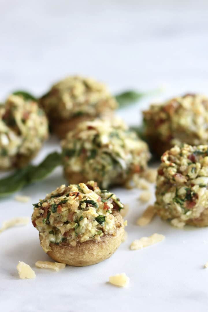 stuffed mushrooms with bacon on marble surface