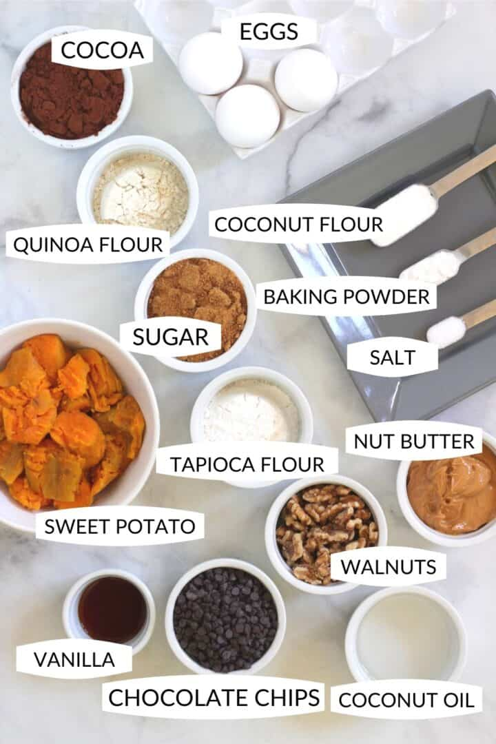 ingredients for sweet potato brownies in individual bowls with labels