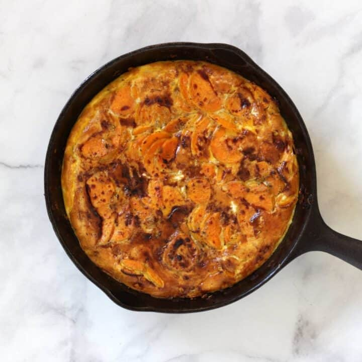 slightly browned, golden sweet potato frittata in pan
