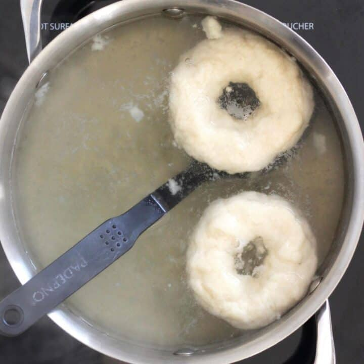 two bagels in large pot of boiling water