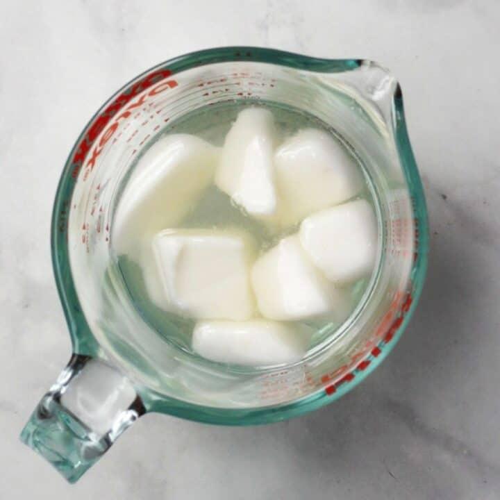 lard melting in water in pyrex measuring cup