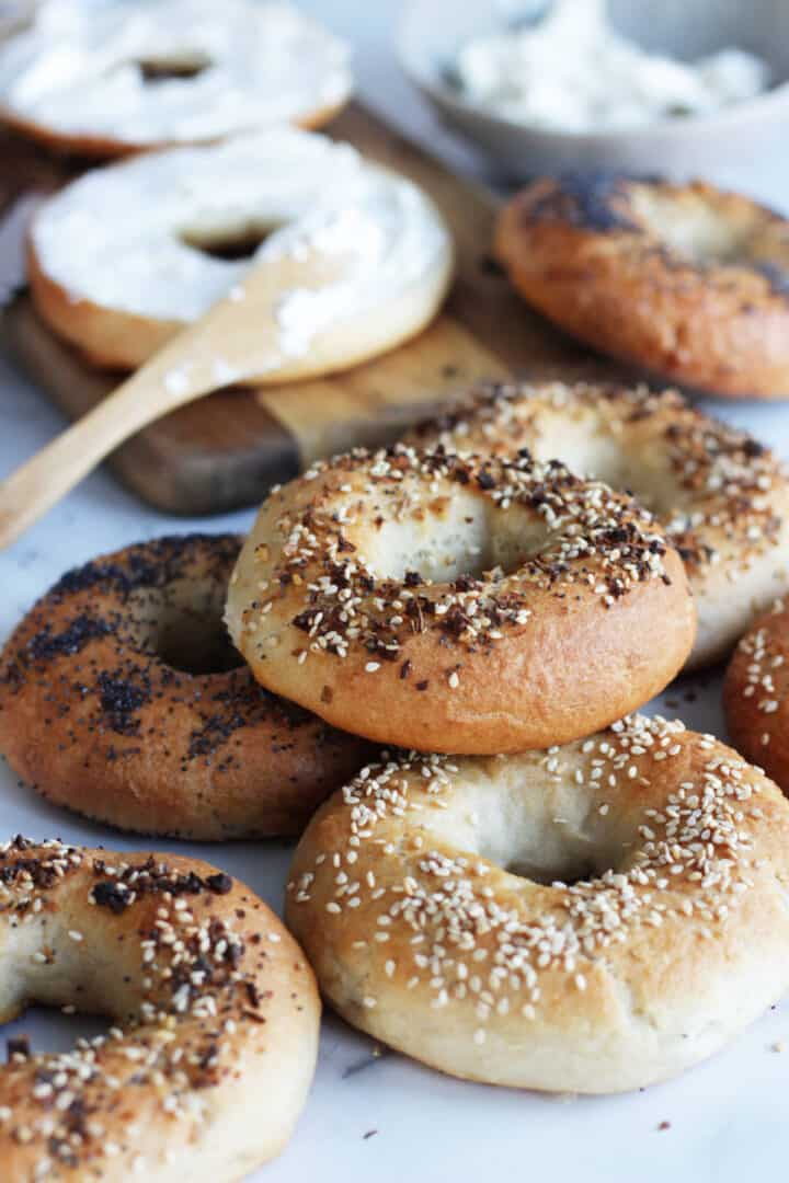 scattered bagels with cream cheese at the back