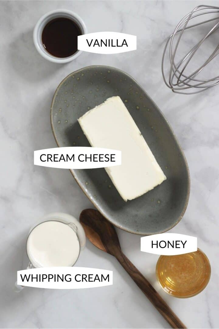 small bowls of vanilla, cream cheese, whipping cream, and honey with labels