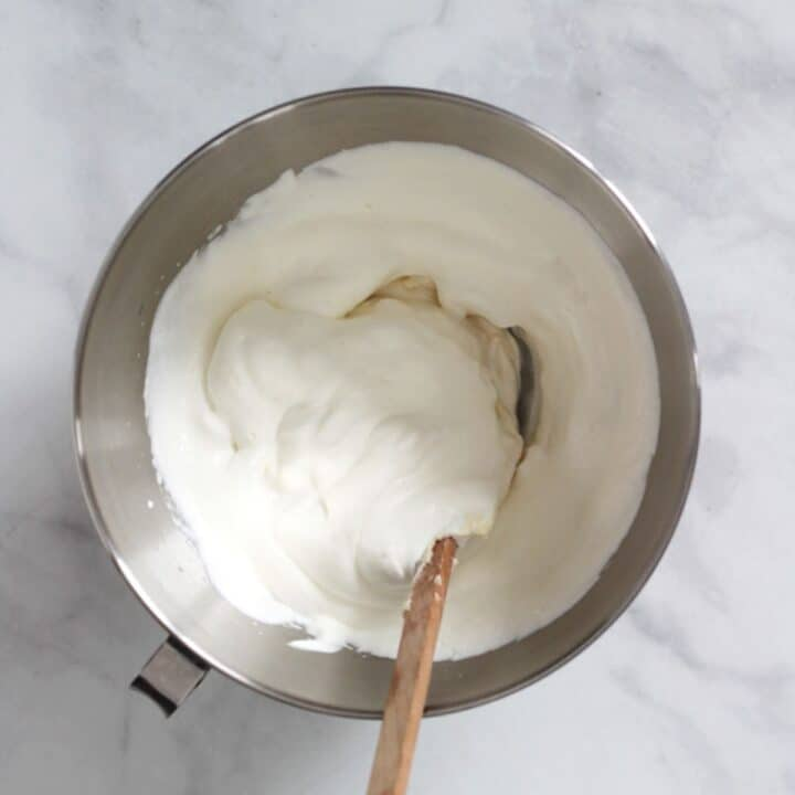 fluffy white mixture in bowl with wooden spatula
