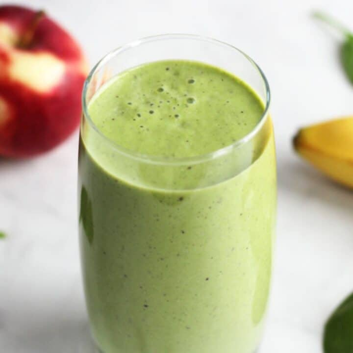 looking down into green smoothie with bubbles on surface