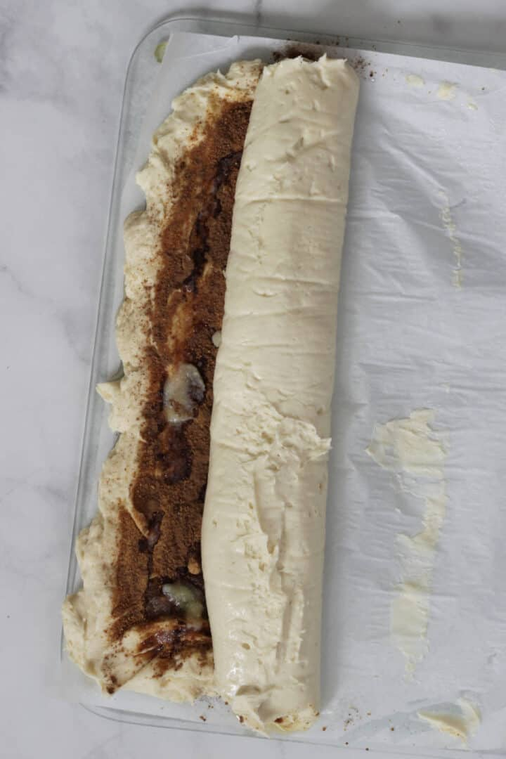 partially rolled dough with some filling still showing