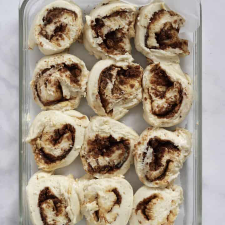 unbaked gluten free cinnamon rolls in pyrex pan