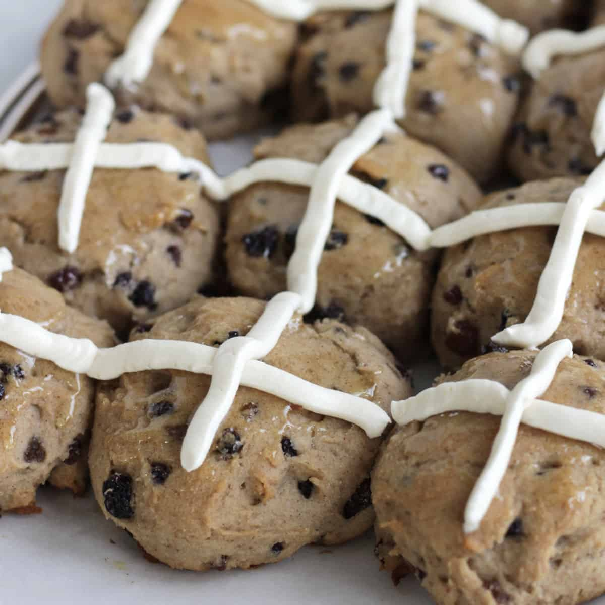 several gluten free hot cross buns in rows