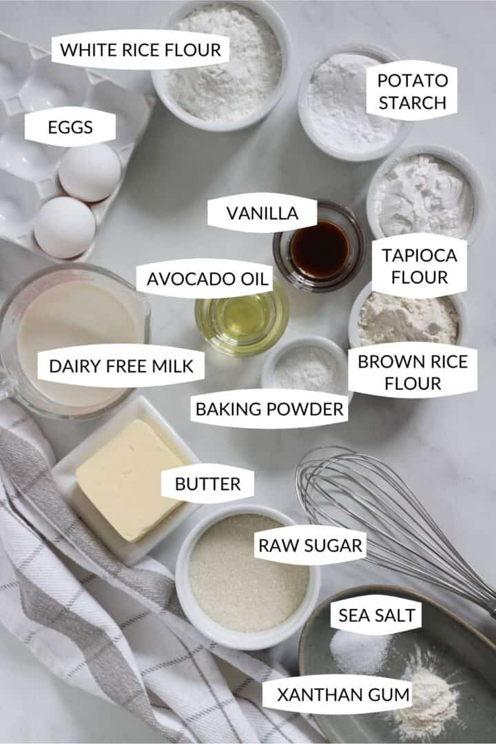 ingredients for gluten free vanilla cake in small bowls with labels