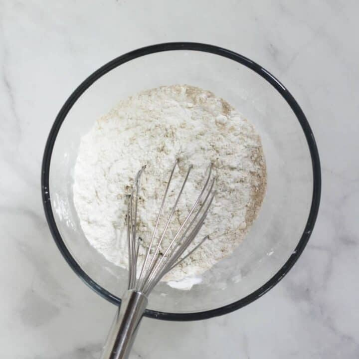 whisk in white flour mixture in glass bowl