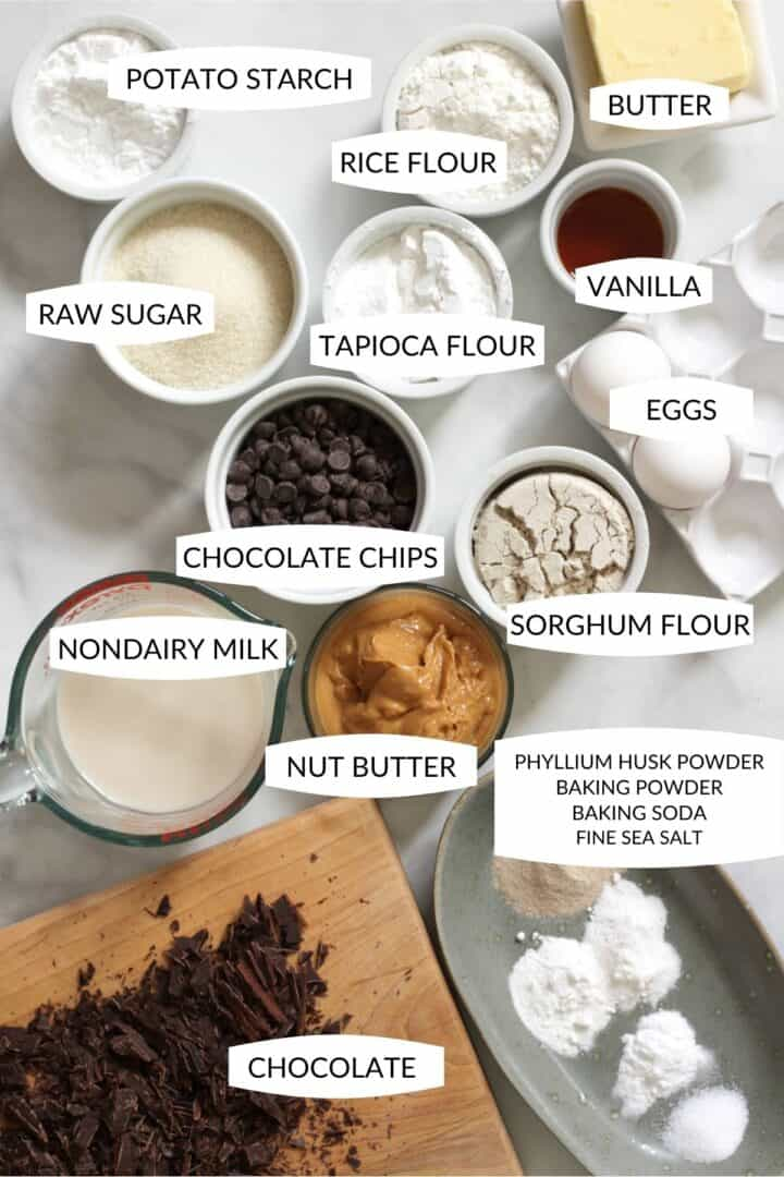 ingredients for gluten free chocolate cake recipe in individual bowls with labels