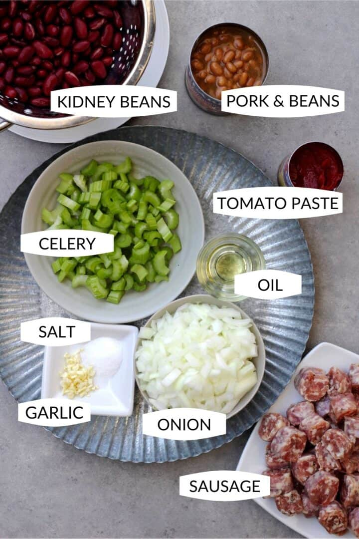 individual ingredients for bean cassoulet in small bowls with labels