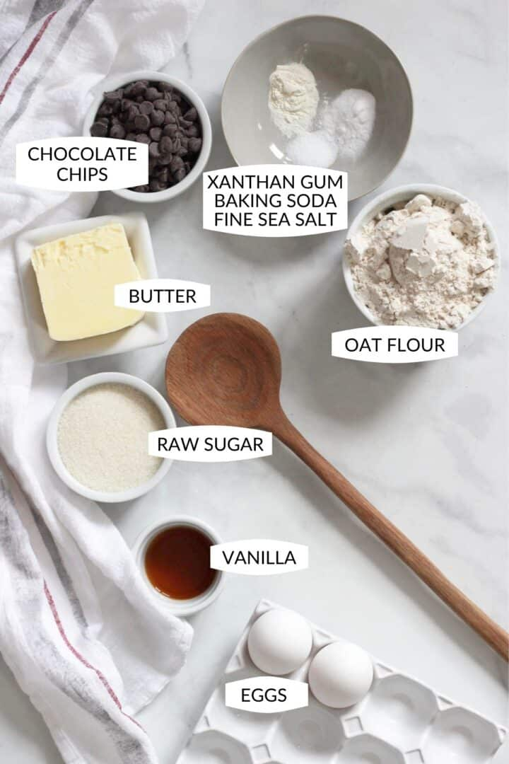 individual ingredients for gf chocolate chip cookies in individual bowls with labels