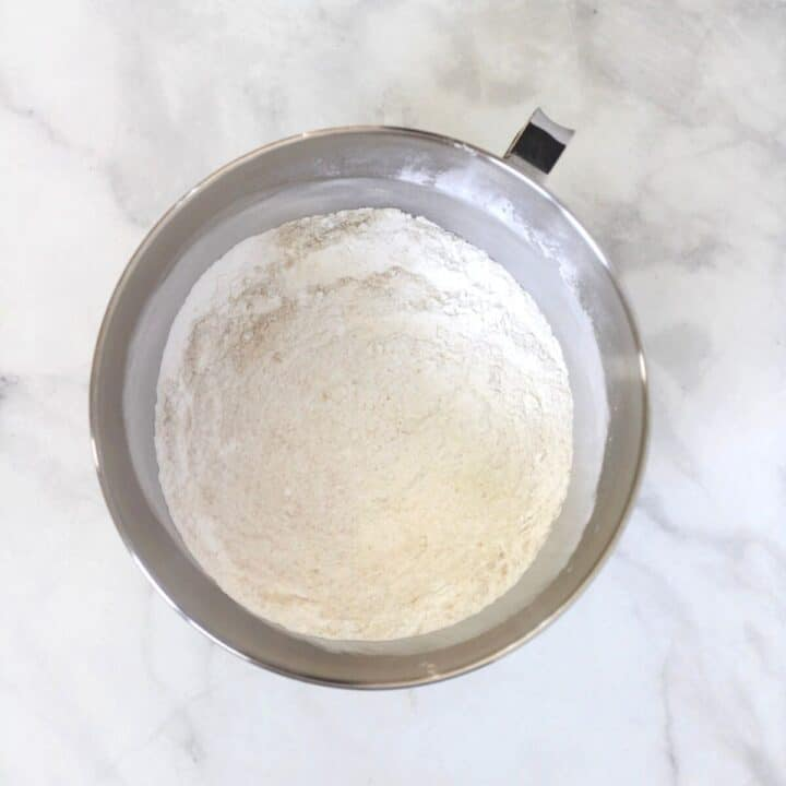 dry, white flour mixture in bowl of stand mixer