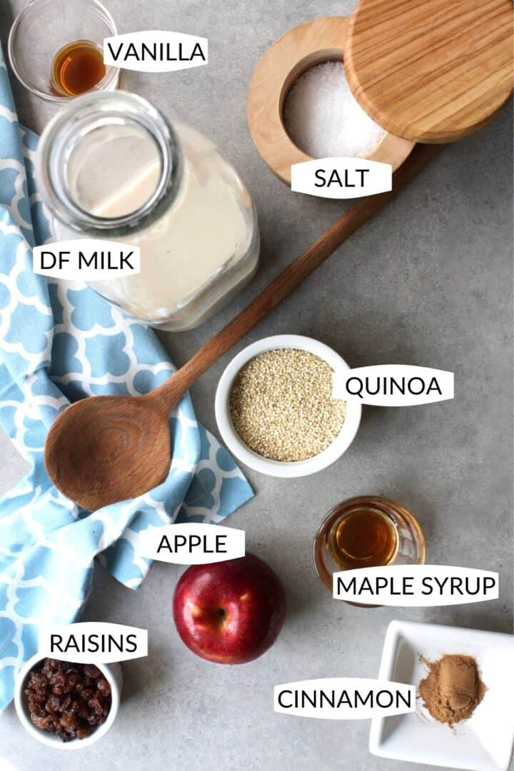 ingredients for apple cinnamon quinoa porridge in individual containers with labels