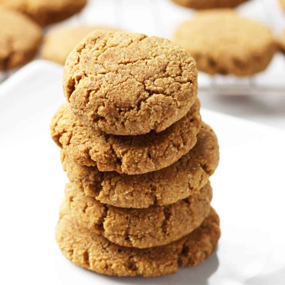 stack of thick, golden cookies on white plate